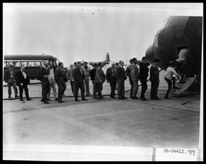 Primary view of object titled 'Men Boarding Plane'.