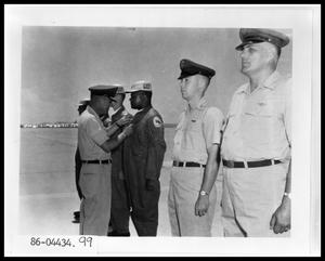 Primary view of object titled 'Officers Presenting Medal'.