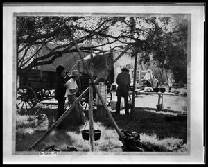 Primary view of object titled 'People Cooking by Wagon'.