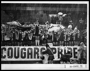 Primary view of object titled 'Cooper High Pep Squad in Rain'.