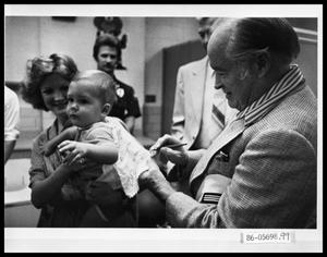 Primary view of object titled 'Bob Hope Signing Autographs'.