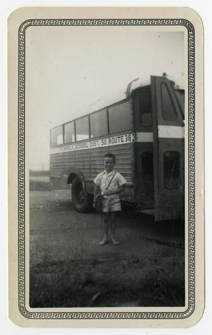 Primary view of object titled '[Thurman Maxwell Standing Next to School Bus]'.