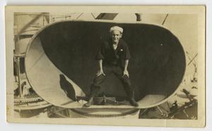 Primary view of object titled '[Photograph of Sailor in U.S.S. Texas Ventilator]'.