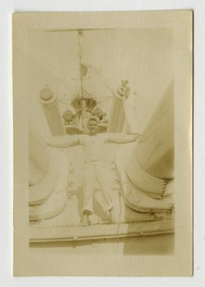 Primary view of object titled '[Photograph of Man on U.S.S. Texas Forecastle]'.