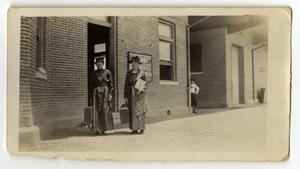 Primary view of object titled '[Mary Grantham Barlow and Nancy Grantham Freeman at Depot in Ireland, Texas]'.