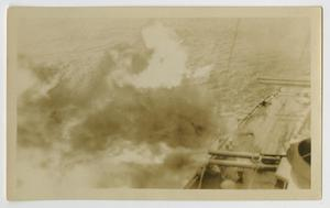 Primary view of object titled '[Photograph of U.S.S. Texas Turret During Battle Practice]'.