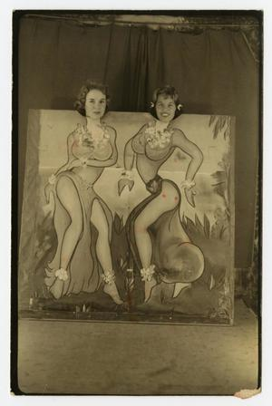 Primary view of object titled '[Photograph of Two Girls Standing Behind Painted Scene]'.