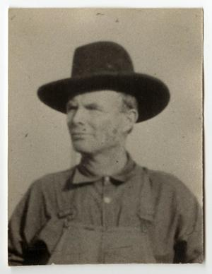 Primary view of object titled '[Alexander Freeman Wearing a Hat and Overalls]'.