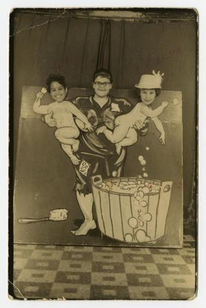 Primary view of object titled '[Photograph of Three Girls Standing Behind Painted Scene]'.