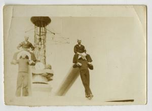 Primary view of object titled '[Photograph of Men on U.S.S. Texas Guns]'.