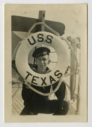 Primary view of object titled '[Photograph of Gene Rogers on U.S.S. Texas]'.
