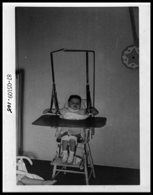 Primary view of object titled 'Child in High Chair'.