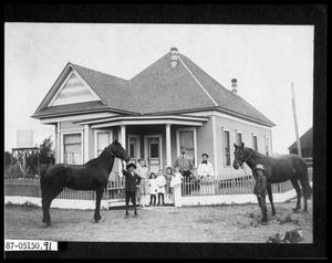 Primary view of object titled 'Family in Front of House'.