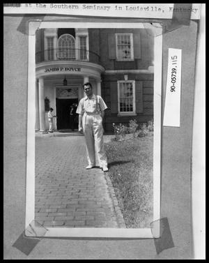 Primary view of object titled 'Student in Front of Building'.