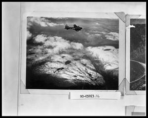 Primary view of object titled 'Plane Flying Over Mountains'.