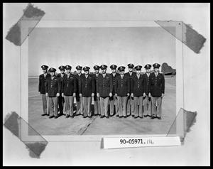 Primary view of object titled 'Fourteen Men Standing on Airfield'.