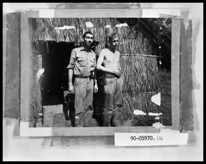 Primary view of object titled 'Two Soldiers By Grass Hut'.