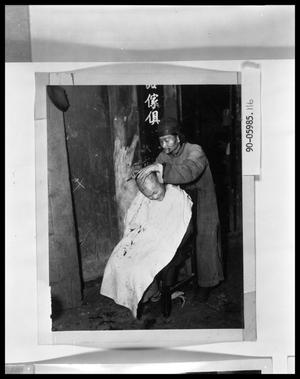 Primary view of object titled 'Oriental Barber Giving Haircut'.