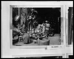 Primary view of object titled 'Oriental Man in Shop'.