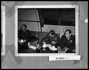 Primary view of object titled 'Military Officers Eating'.