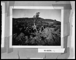 Primary view of object titled 'Five Men on Rock Near Airfield'.