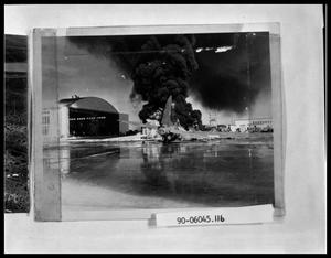 Primary view of object titled 'Plane on Fire near Hanger'.