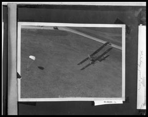 Primary view of object titled 'Man Jumping from Bi-Plane'.