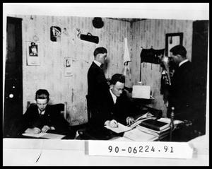 Primary view of object titled 'Four Men in Dorm Room'.