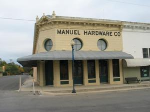 Primary view of object titled '[Manuel Hardware Building Photograph #1]'.