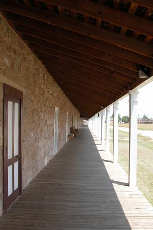 Primary view of object titled 'Fort Concho, long covered porch of Cavalry Barracks 1'.