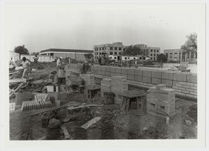 Primary view of object titled '[Photograph of Laying Blocks for the Mabee Dining Hall]'.