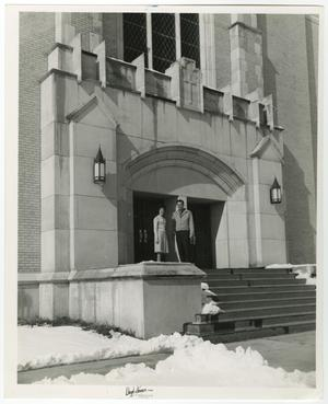 Primary view of object titled '[Photograph of Two Students Standing in Front of Radford Hall]'.