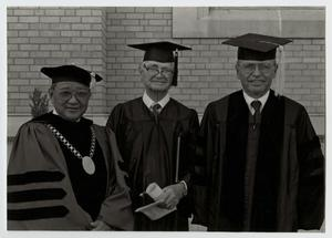 Primary view of object titled '[Photograph of Dr. Kim in Cap and Gown]'.