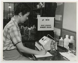 Primary view of object titled '[Photograph of Student Working with pH Meter]'.