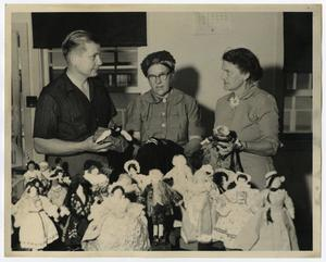Primary view of object titled '[Photograph of Andrew Hunt, Unknown Woman, and Vernie Newman with Dolls]'.