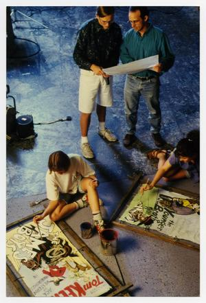 Primary view of object titled '[Photograph of Students Painting Movie Signs]'.