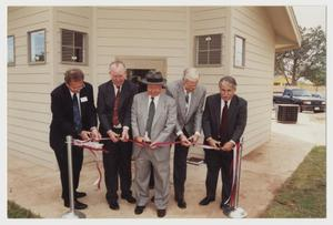 Primary view of object titled '[Photograph of Ribbon Cutting for Student Apartments]'.