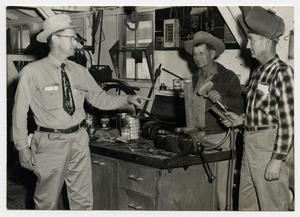 Primary view of object titled '[Photograph of Harvey Pinner in Maintenance Shop]'.