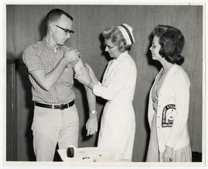 Primary view of [Photograph of Student Receiving Vaccination]