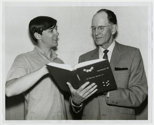 Primary view of object titled '[Photograph of Dr. W. Norton Jones, Jr., with Student]'.