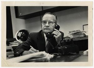 Primary view of object titled '[Photograph of Ed Wishcamper on Telephone]'.