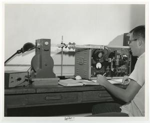 Primary view of object titled '[Photograph of McMurry Student Working in Science Lab]'.