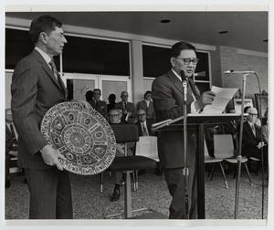 Primary view of object titled '[Photograph of Dr. Thomas Kim Speaking]'.