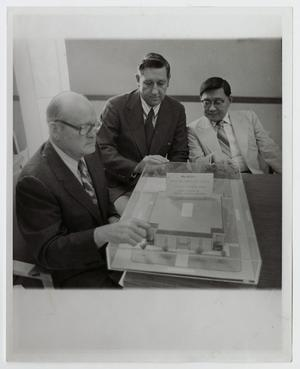 Primary view of object titled '[Photograph of Dr. Kim with Recreation Building Model]'.