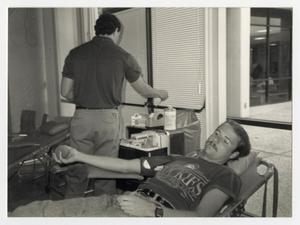 Primary view of object titled '[Photograph of Student Donating Blood]'.