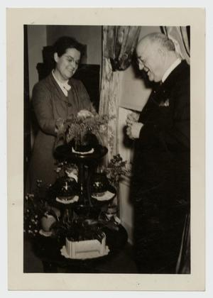 Primary view of object titled '[Photograph of Dr. and Mrs. Harold G. Cooke at Home]'.