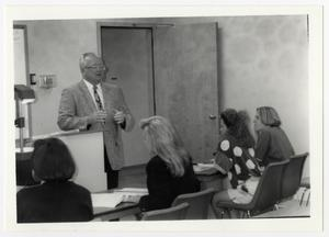Primary view of object titled '[Photograph of Terry Northrup at Front of Classroom]'.