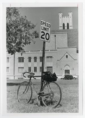 Primary view of object titled '[Photograph of Bicycle and Radford Auditorium]'.
