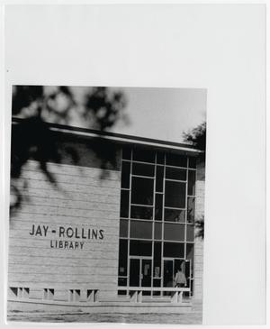 Primary view of object titled '[Photograph of Student Entering Jay-Rollins Library]'.
