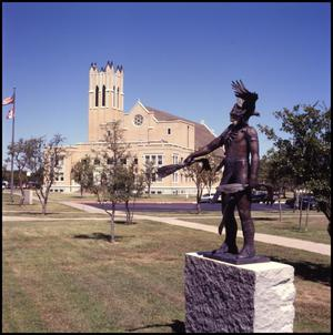 Primary view of object titled '[Photograph of Sacred Wind Sculpture and Radford Hall]'.